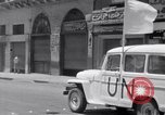 Image of White UN van displaying a white flag Tripoli Libya, 1962, second 33 stock footage video 65675039879
