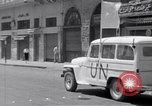 Image of White UN van displaying a white flag Tripoli Libya, 1962, second 34 stock footage video 65675039879