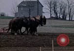 Image of Farmer plowing field New York United States USA, 1970, second 25 stock footage video 65675040534