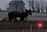 Image of Farmer plowing field New York United States USA, 1970, second 26 stock footage video 65675040534