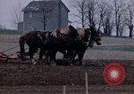 Image of Farmer plowing field New York United States USA, 1970, second 27 stock footage video 65675040534