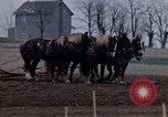 Image of Farmer plowing field New York United States USA, 1970, second 29 stock footage video 65675040534