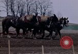 Image of Farmer plowing field New York United States USA, 1970, second 33 stock footage video 65675040534