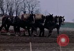 Image of Farmer plowing field New York United States USA, 1970, second 34 stock footage video 65675040534