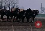 Image of Farmer plowing field New York United States USA, 1970, second 35 stock footage video 65675040534