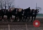 Image of Farmer plowing field New York United States USA, 1970, second 36 stock footage video 65675040534