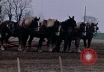 Image of Farmer plowing field New York United States USA, 1970, second 37 stock footage video 65675040534