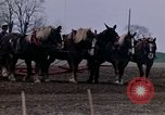 Image of Farmer plowing field New York United States USA, 1970, second 38 stock footage video 65675040534