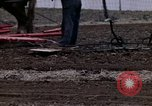 Image of Farmer plowing field New York United States USA, 1970, second 59 stock footage video 65675040534