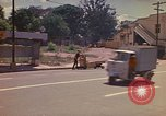 Image of Busy street Montego Bay Jamaica, 1972, second 21 stock footage video 65675040556