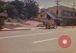 Image of Busy street Montego Bay Jamaica, 1972, second 25 stock footage video 65675040556