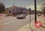 Image of Busy street Montego Bay Jamaica, 1972, second 28 stock footage video 65675040556
