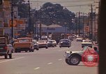 Image of Busy street Montego Bay Jamaica, 1972, second 31 stock footage video 65675040556