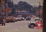 Image of Busy street Montego Bay Jamaica, 1972, second 32 stock footage video 65675040556