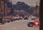 Image of Busy street Montego Bay Jamaica, 1972, second 33 stock footage video 65675040556