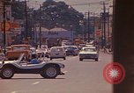 Image of Busy street Montego Bay Jamaica, 1972, second 34 stock footage video 65675040556