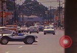 Image of Busy street Montego Bay Jamaica, 1972, second 35 stock footage video 65675040556