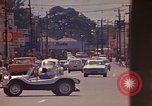 Image of Busy street Montego Bay Jamaica, 1972, second 37 stock footage video 65675040556