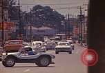 Image of Busy street Montego Bay Jamaica, 1972, second 38 stock footage video 65675040556
