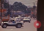 Image of Busy street Montego Bay Jamaica, 1972, second 39 stock footage video 65675040556