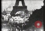 Image of Eiffel tower Paris France, 1900, second 7 stock footage video 65675040586