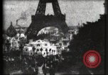 Image of Eiffel tower Paris France, 1900, second 8 stock footage video 65675040586