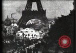 Image of Eiffel tower Paris France, 1900, second 13 stock footage video 65675040586