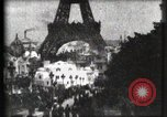 Image of Eiffel tower Paris France, 1900, second 17 stock footage video 65675040586