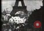 Image of Eiffel tower Paris France, 1900, second 18 stock footage video 65675040586