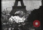 Image of Eiffel tower Paris France, 1900, second 25 stock footage video 65675040586