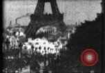 Image of Eiffel tower Paris France, 1900, second 32 stock footage video 65675040586