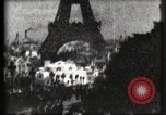 Image of Eiffel tower Paris France, 1900, second 52 stock footage video 65675040586