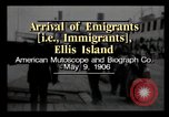 Image of Immigrants arriving at Ellis Island New York City USA, 1906, second 1 stock footage video 65675040611