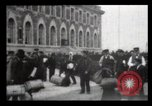 Image of Immigrants arriving at Ellis Island New York City USA, 1906, second 33 stock footage video 65675040611