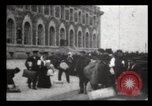 Image of Immigrants arriving at Ellis Island New York City USA, 1906, second 39 stock footage video 65675040611