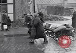 Image of German people gather fuel coal at end of War Munich Germany, 1945, second 24 stock footage video 65675040678