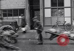 Image of German people gather fuel coal at end of War Munich Germany, 1945, second 31 stock footage video 65675040678