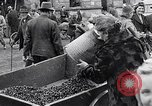 Image of German people gather fuel coal at end of War Munich Germany, 1945, second 57 stock footage video 65675040678