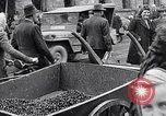 Image of German people gather fuel coal at end of War Munich Germany, 1945, second 59 stock footage video 65675040678