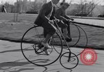 Image of riding bicycles New York City USA, 1932, second 13 stock footage video 65675040752