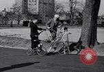 Image of riding bicycles New York City USA, 1932, second 18 stock footage video 65675040752