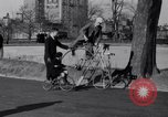 Image of riding bicycles New York City USA, 1932, second 19 stock footage video 65675040752
