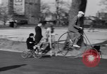 Image of riding bicycles New York City USA, 1932, second 22 stock footage video 65675040752