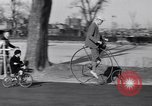 Image of riding bicycles New York City USA, 1932, second 23 stock footage video 65675040752