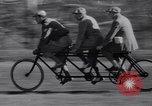 Image of riding bicycles New York City USA, 1932, second 29 stock footage video 65675040752
