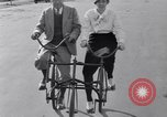 Image of riding bicycles New York City USA, 1932, second 33 stock footage video 65675040752