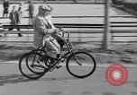 Image of riding bicycles New York City USA, 1932, second 36 stock footage video 65675040752