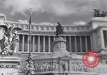 Image of allied soldiers in front of The Monument to Victor Emanuel II Italy, 1944, second 12 stock footage video 65675040763
