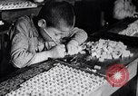 Image of Japanese workers and training of children for war Japan, 1941, second 18 stock footage video 65675040809