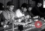 Image of Japanese workers and training of children for war Japan, 1941, second 35 stock footage video 65675040809